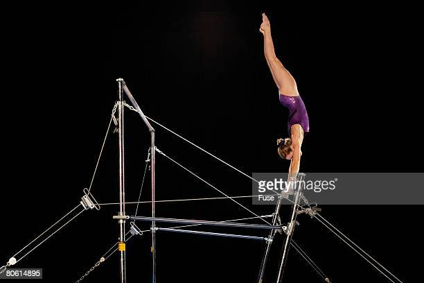 gymnast on uneven parallel bars - horizontal bars stock pictures, royalty-free photos & images