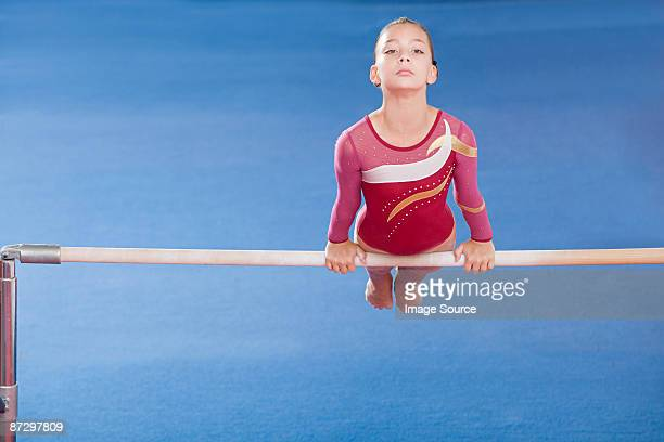 gymnast on unparallel bars - horizontal bars stock pictures, royalty-free photos & images