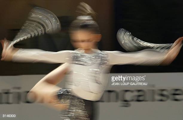 gymnast perform her program 27 march 2004 in Thiais during a training session of the World Championships of Rhytmic Gymnastics AFP PHOTO JEANLOUP...