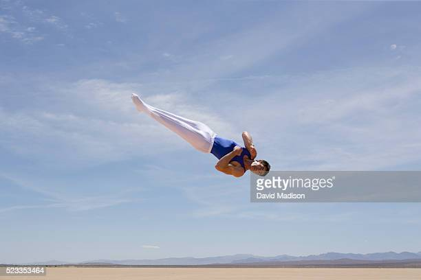 gymnast performing in the desert - madison grace stock pictures, royalty-free photos & images