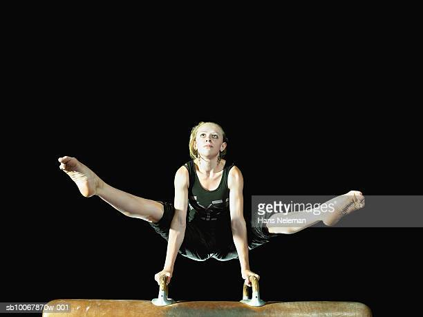 Gymnast performing on pommel horse