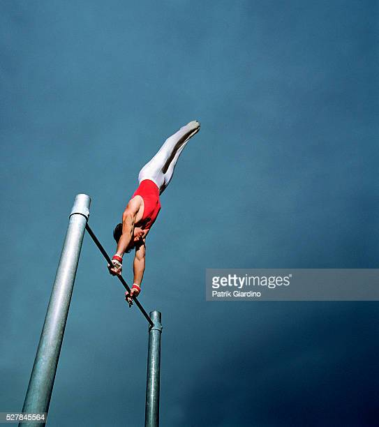 Gymnast Performing Routine On High Bar