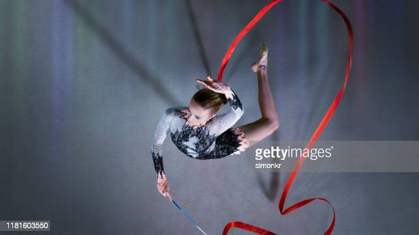 gymnast performing with ribbon - rhythmic gymnastics stock pictures, royalty-free photos & images