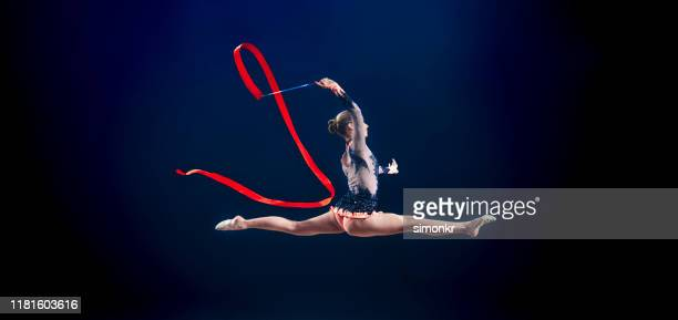 gymnast performing with ribbon - leotard stock pictures, royalty-free photos & images