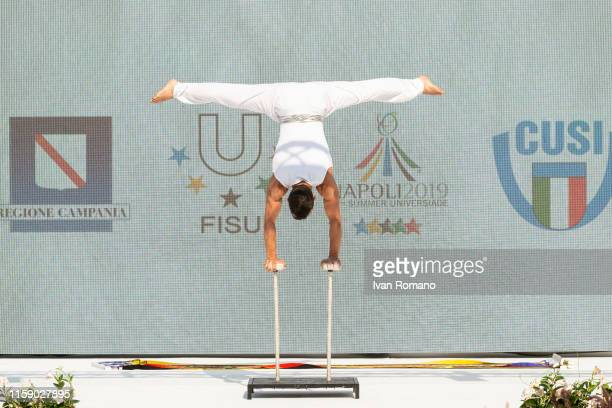 A gymnast performs during the ceremony of the opening of the athletes village of the Universiade 2019 on June 28 2019 in Naples Italy
