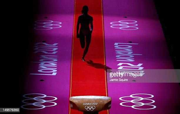 A gymnast performs during warmups before the start of the Artistic Gymnastics Women's Team final on Day 4 of the London 2012 Olympic Games at North...