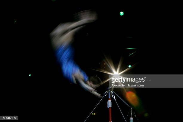 A gymnast performs on the horizontal bar during the international German gymnastics festival show of the masters on May 20 2005 in Berlin Germany