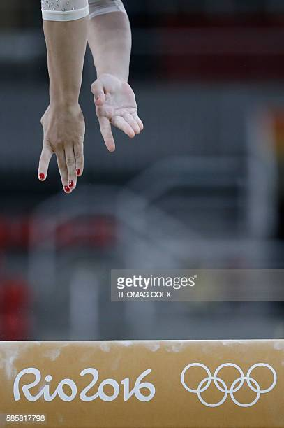 Gymnast practices on the balance beam of the women's Artistic gymnastics on August 4, 2016 ahead of the Rio 2016 Olympic Games in Rio de Janeiro. /...