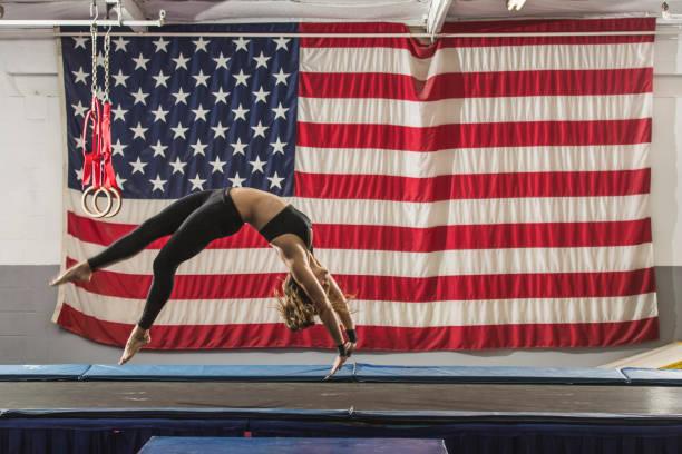 Gymnast practicing floor routine at gym