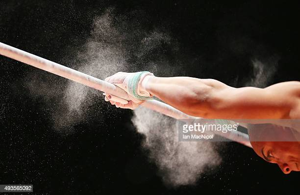A gymnast practises on the High Bar during the 2015 World Artistic Gymnastics Championships Media Session at The SSE Hydro on October 21 2015 in...