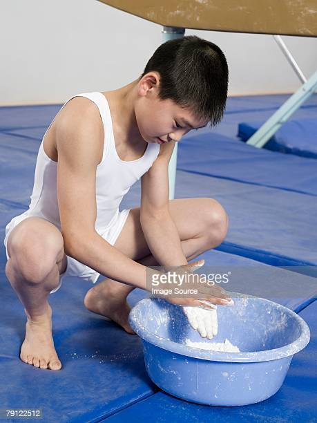 Gymnast putting chalk on his hands