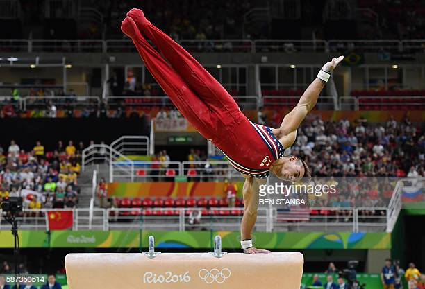 TOPSHOT US gymnast Samuel Mikulak competes in the pommel horse event of the men's team final of the Artistic Gymnastics at the Olympic Arena during...