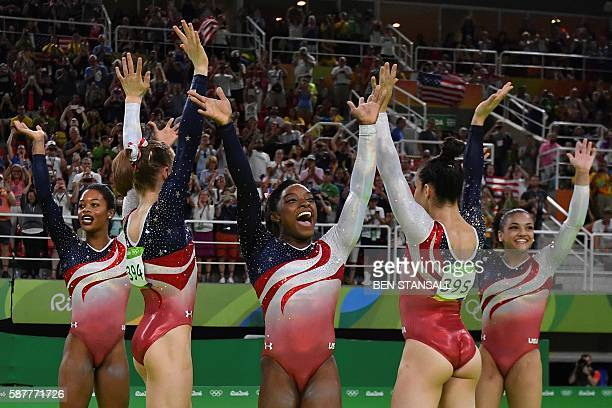 TOPSHOT US gymnast Simone Biles and her teammates celebrate after winning the women's team final Artistic Gymnastics at the Olympic Arena during the...
