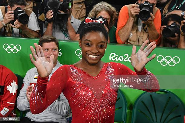 TOPSHOT US gymnast Simone Biles celebrates after competing in the women's vault event final of the Artistic Gymnastics at the Olympic Arena during...