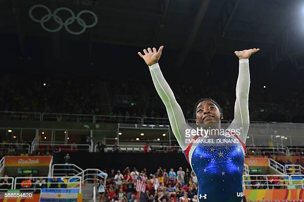 TOPSHOT US gymnast Simone Biles celebrates after the women's individual allaround final of the Artistic Gymnastics at the Olympic Arena during the...
