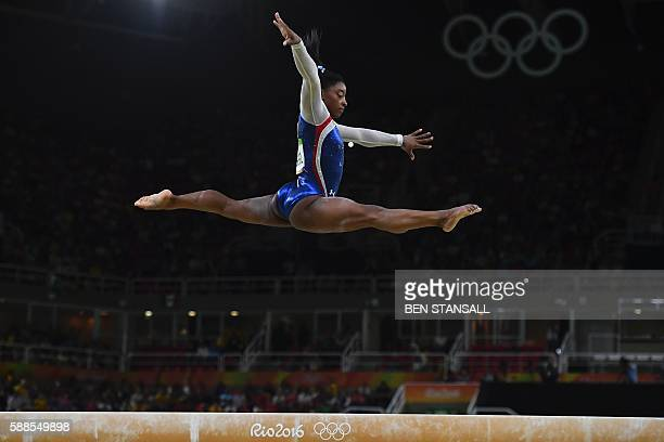 US gymnast Simone Biles competes in the beam event of the women's individual allaround final of the Artistic Gymnastics at the Olympic Arena during...