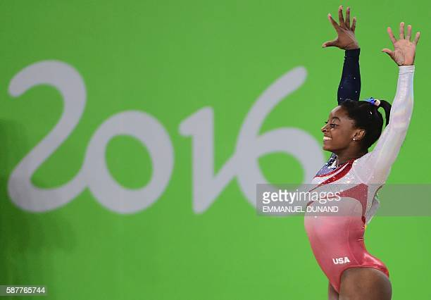 TOPSHOT US gymnast Simone Biles competes in the Floor event during the women's team final Artistic Gymnastics at the Olympic Arena during the Rio...