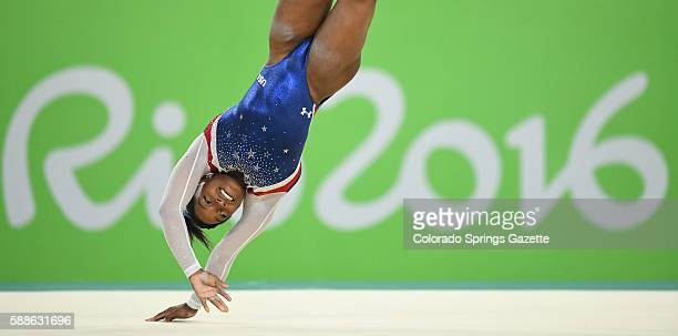 US gymnast Simone Biles competes in the floor exercise in the women's AllAround Individual at the Summer Olympics in Rio de Janeiro Brazil on...