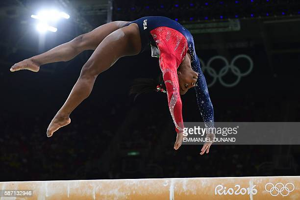 TOPSHOT US gymnast Simone Biles competes in the qualifying for the women's Beam event of the Artistic Gymnastics at the Olympic Arena during the Rio...