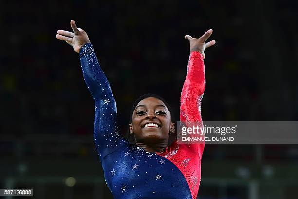 US gymnast Simone Biles competes in the qualifying for the women's Vault event of the Artistic Gymnastics at the Olympic Arena during the Rio 2016...