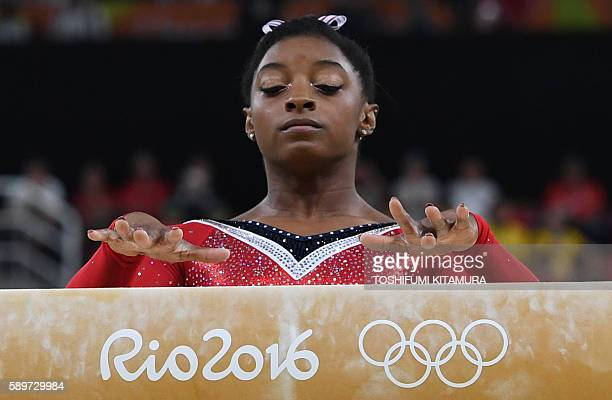 TOPSHOT US gymnast Simone Biles competes in the women's balance beam event final of the Artistic Gymnastics at the Olympic Arena during the Rio 2016...