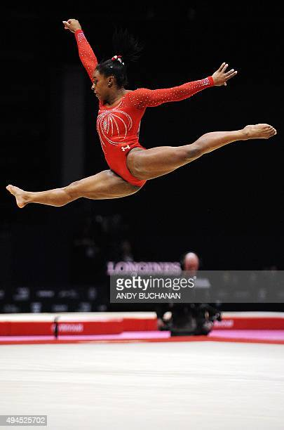 US gymnast Simone Biles competes on the floor during the Women's Team event final on the fifth day of the 2015 World Gymnastics Championship in...