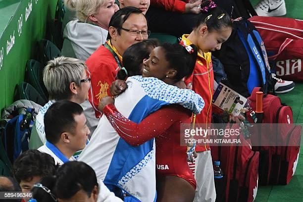 Gymnast Simone Biles is congratulated by Uzbekistan's Oksana Chusovitina after the women's vault event final of the Artistic Gymnastics at the...