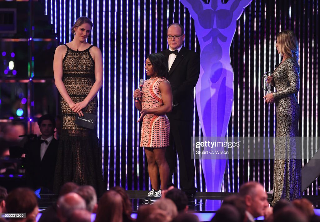 Gymnast Simone Biles of the US the winner of the Laureus World Sportswoman of the Year Award is congratulated by Prince Albert II of Monaco and Laureus Academy member Nadia Comaneci as Laureus Ambassador Missy Franklin looks on during the 2017 Laureus World Sports Awards at the Salle des Etoiles,Sporting Monte Carlo on February 14, 2017 in Monaco, Monaco.