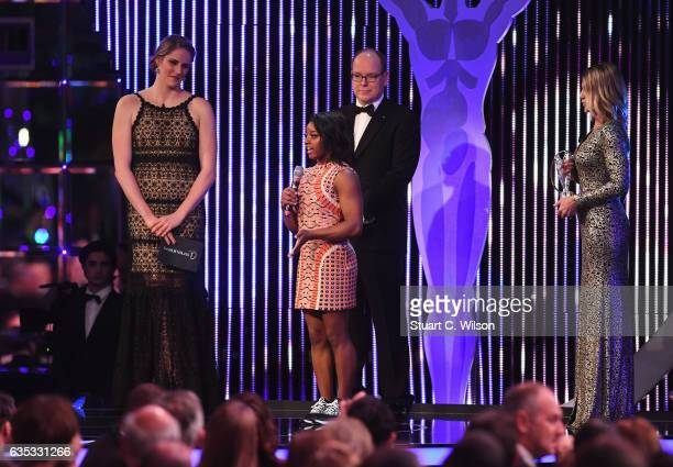 Gymnast Simone Biles of the US the winner of the Laureus World Sportswoman of the Year Award is congratulated by Prince Albert II of Monaco and...