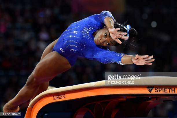 Gymnast Simone Biles performs on the vault during a training session at the FIG Artistic Gymnastics World Championships in Stuttgart, southern...