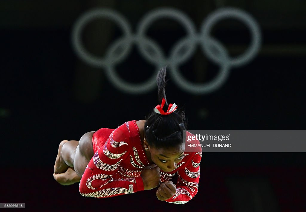 TOPSHOT - US gymnast Simone Biles practics on the vault during a training session at the women's Artistic gymnastics at the Olympic Arena on August 4, 2016 ahead of the Rio 2016 Olympic Games in Rio de Janeiro. / AFP / EMMANUEL