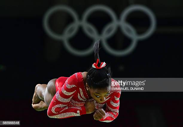 TOPSHOT US gymnast Simone Biles practics on the vault during a training session at the women's Artistic gymnastics at the Olympic Arena on August 4...