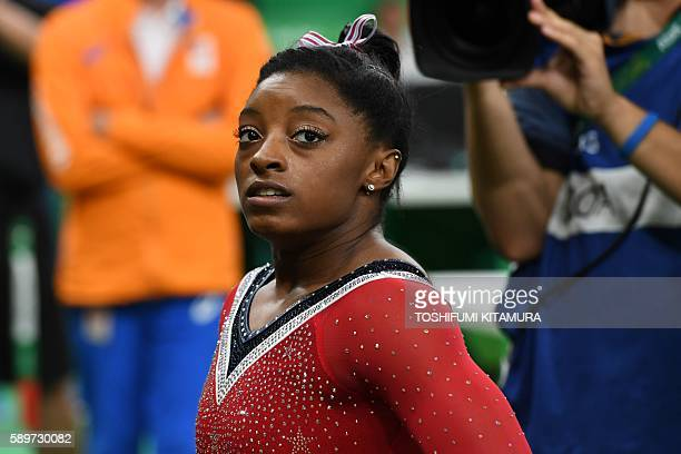 TOPSHOT US gymnast Simone Biles reacts after competing in the women's balance beam event final of the Artistic Gymnastics at the Olympic Arena during...