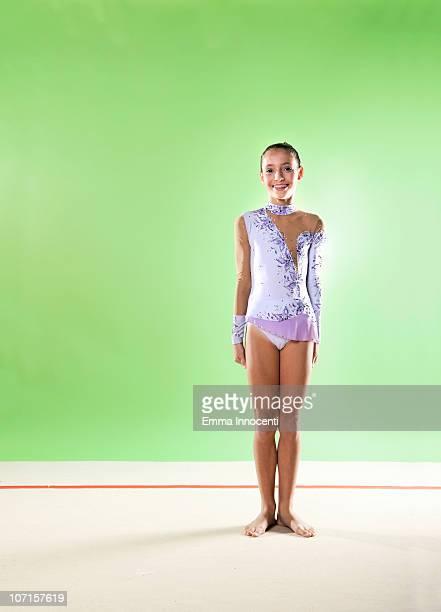 gymnast, smiling, standing, purple leotard