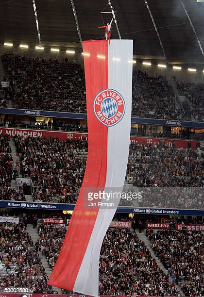 A gymnast stands on a FC Bayern Munich team flag at the show act before the opening game between FC Bayern Munich and the German Nationalteam in the...