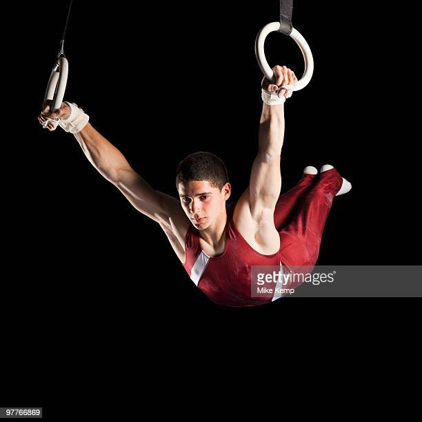 Gymnast swinging from rings