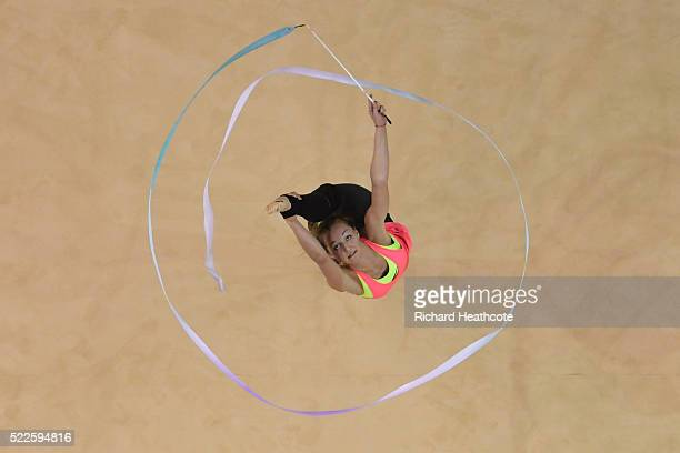 A gymnast takes part in an open training session for the rhythmic gymnastics test event at the Rio Olympic Arena on April 20 2016 in Rio de Janeiro...