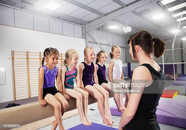 Gymnast trainer with group of girls