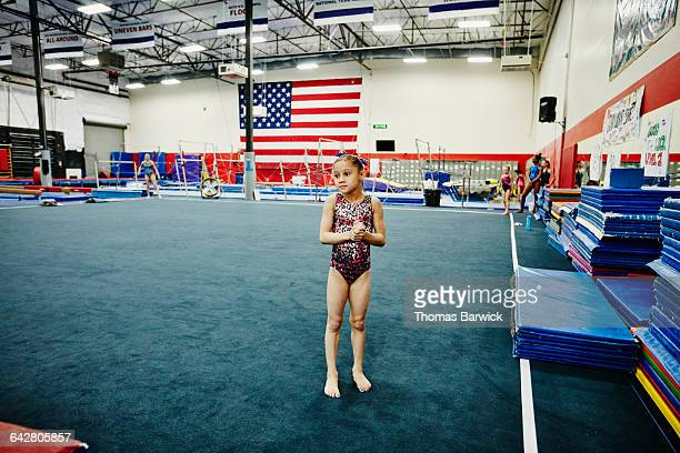 Gymnast waiting on floor during training session