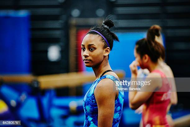 Gymnast watching teammates during training session