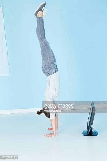 Gymnast Watching Television Whilst Doing A Handstand