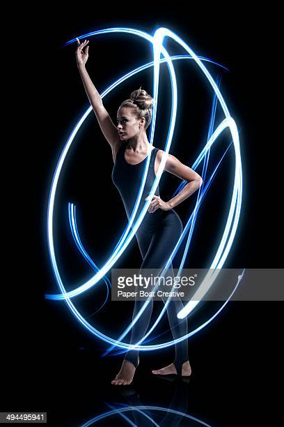 Gymnast with large blue electric strokes around he