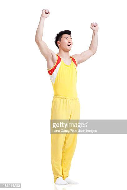Gymnastic athlete punching the air