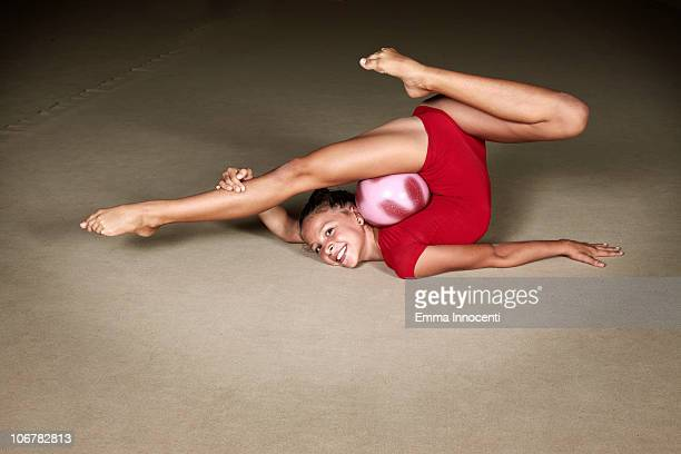 gymnastic, bending over backwards, smile, ball - legs apart stock photos and pictures