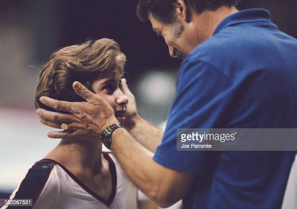 Gymnastic coach Bela Karolyi talks to Phoebe Mills of the United States during the Women's Balance Beam on 25th September 1988 during the XXIV Summer...