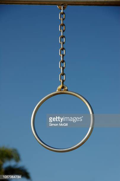 gymnastic gym ring hoop, part of the exercise and fitness equipment at a public park - gold chain necklace stock pictures, royalty-free photos & images
