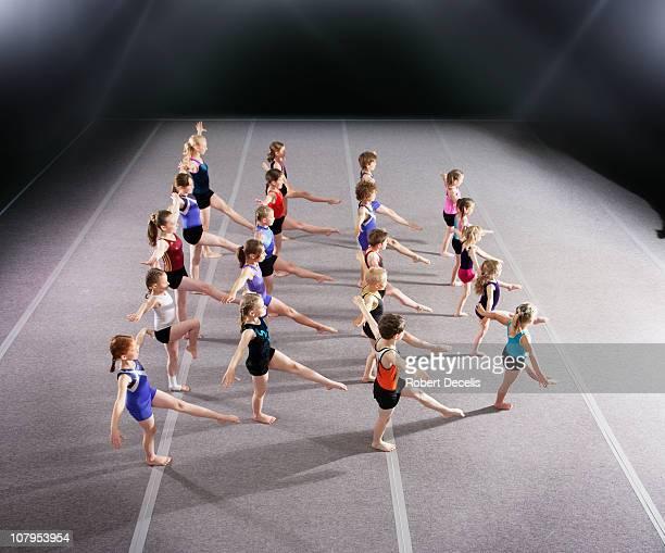 Gymnastic squad perforiming warm up routine