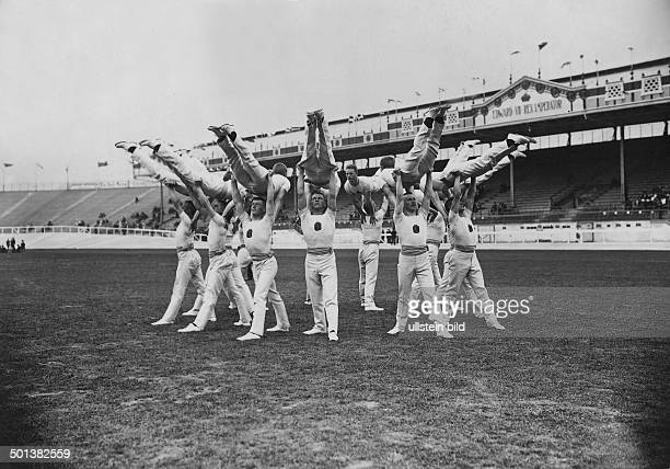 gymnasts of the Finnish team doing exercises in the 'White City' Olympic Stadium in Shepherds Bush 1908