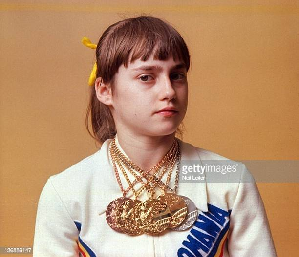 Gymnastics 1976 Summer Olympics Closeup portrait of Romania Nadia Comaneci with gold and silver medals during photo shoot Montreal Canada 7/24/1976...