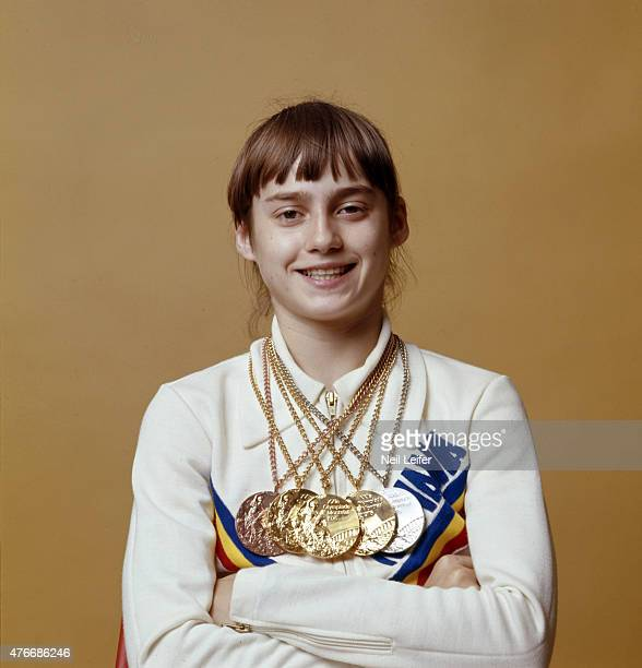 1976 Summer Olympics Closeup portrait of Romania Nadia Comaneci with gold and silver medals during photo shoot Montreal Canada 7/24/1976 CREDIT Neil...